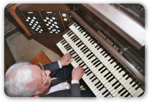 Overheadshot of Man Playing Pipe Organ